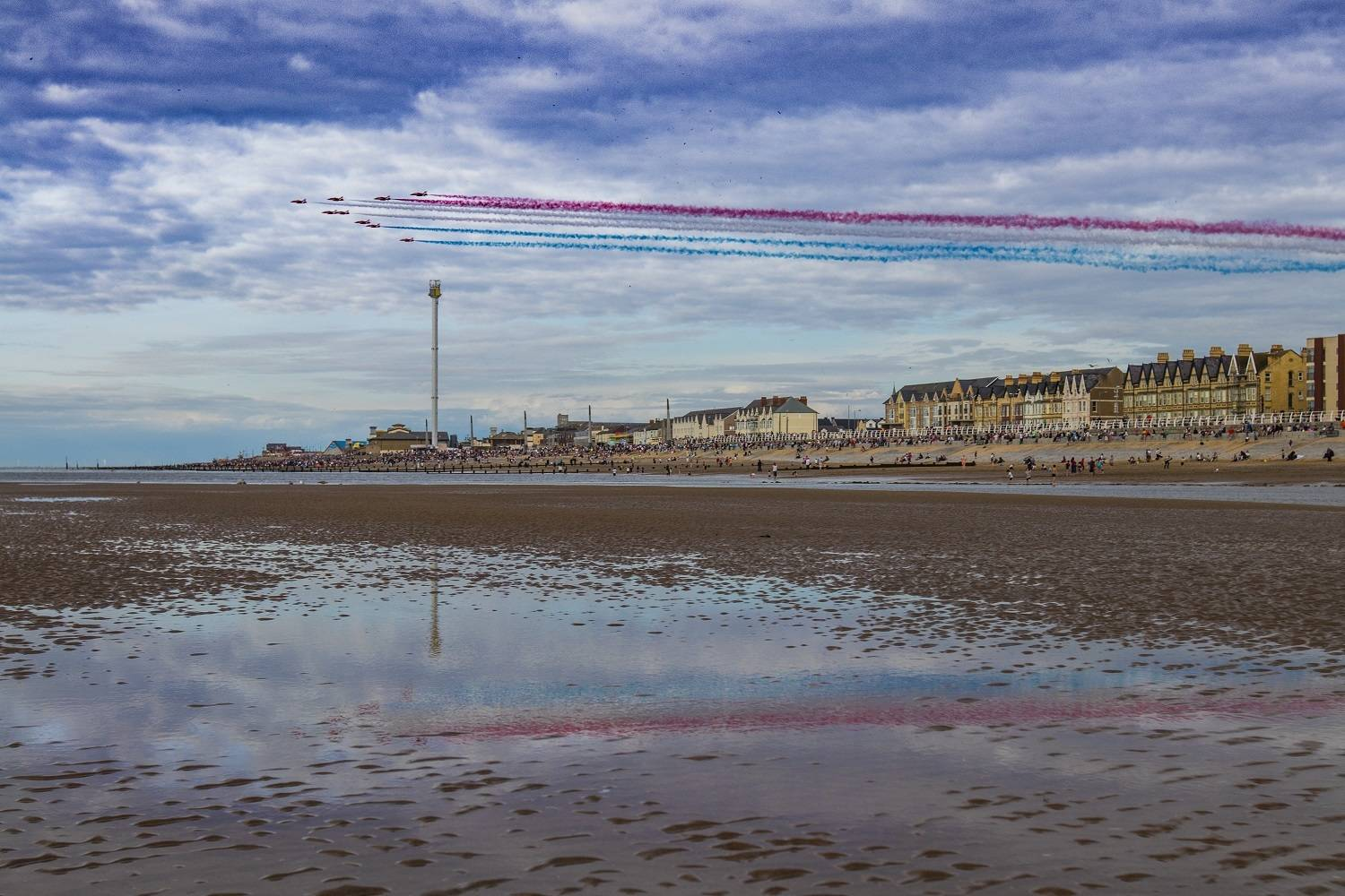 A photograph of the red arrows flying display over Rhyl beach